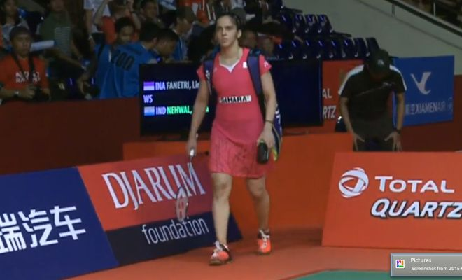 Saina Nehwal makes her way onto the court as she gets ready for her semifinal bout against Lindaweni Fanetri of Indonesia.
