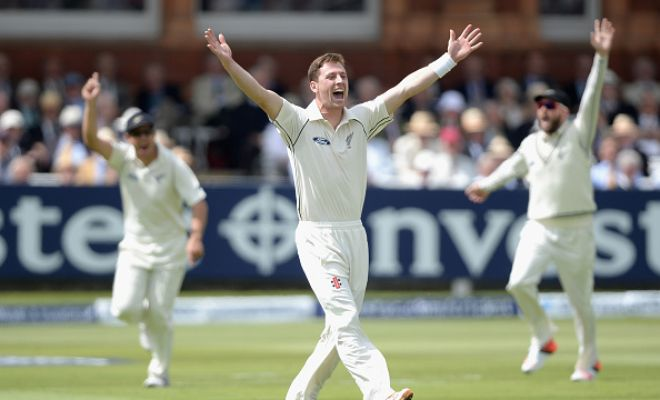 Matt Henry celebrates after picking up his first wicket in Test cricket.