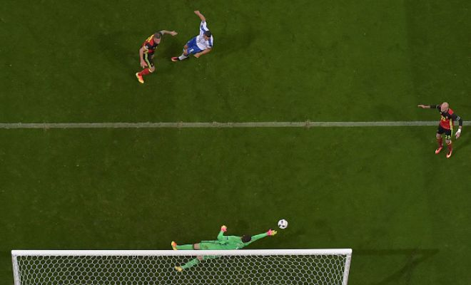 Here is fantastic image of Courtois' save.