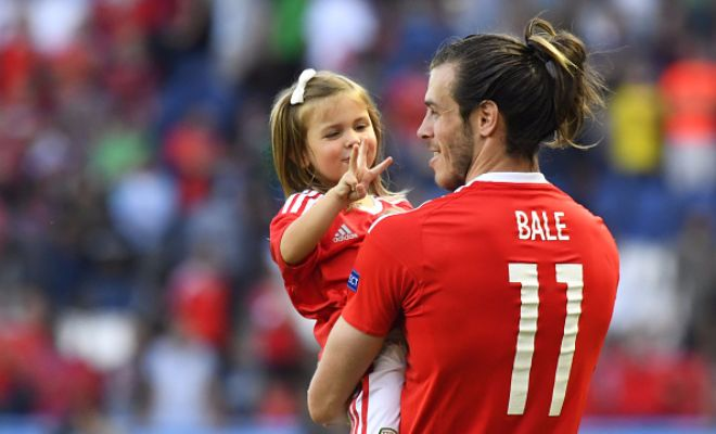 Bale with his daughter Alba Viola after the game: