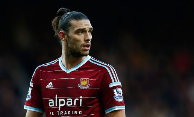 Reigning Europa League champions Sevilla are said to be interested in signing West Ham striker Andy Carroll on loan. [Times]
