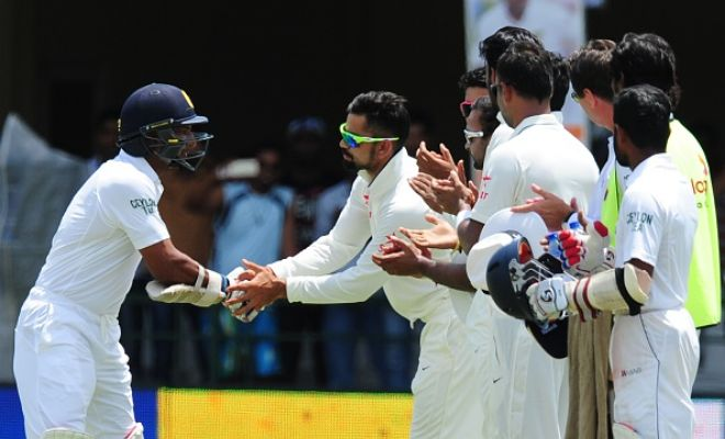 Indian team congratulating Kumar Sangakkara today.