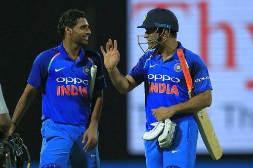 MS Dhoni (right) scored an unbeaten 45 against Sri Lanka last night