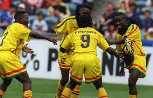 Ghana celebrate after they scored their first goal