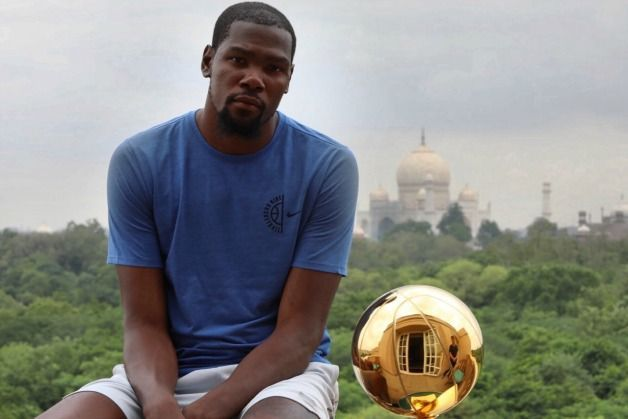Kevin Durant with the NBA Championship trophy at Agra with the Taj Mahal in the background. Image Source: NBA India