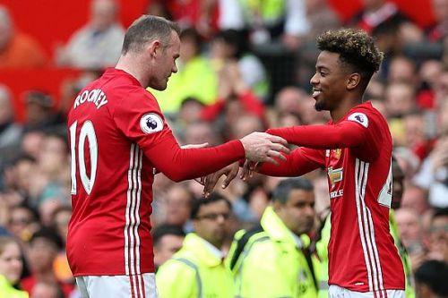 Angel Gomes and Wayne Rooney
