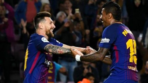Lionel Messi and Paulinho celebrate a Barcelona goal vs Eibar