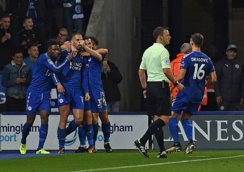 Leicester players celebrate Slimani's second goal