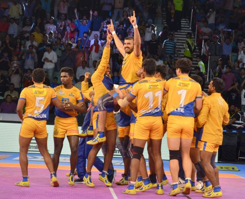 Ajay Thakur is hoisted up by his teammates after his heroics in the final action of the game