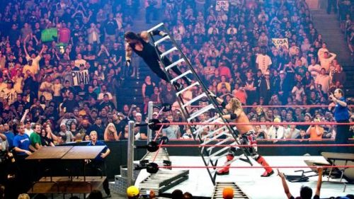 The Undertaker is pushed off a ladder by Edge in a WWE Tables, Ladders and Chairs match; the TLC match has become a huge attraction in WWE