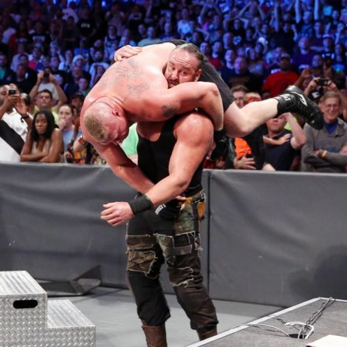 Braun Strowman getting ready to put Brock Lesnar through a table at Summerslam