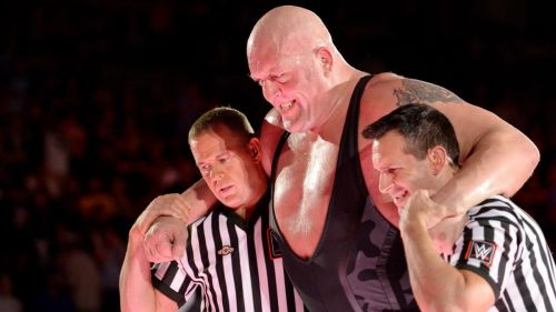 Big Show being helped to the back after his recent cage match
