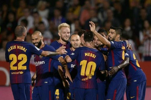 Barcelona players celebrating after Suarez's goal against Girona