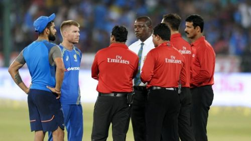 The two captains in discussion with the match officials. Photo credits - AFP