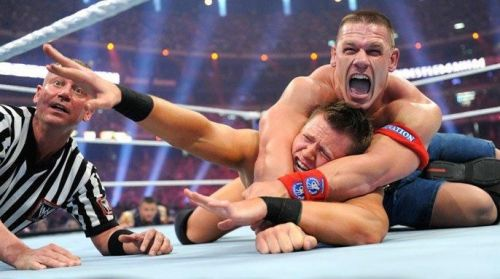 John Cena applies the STF to The Miz