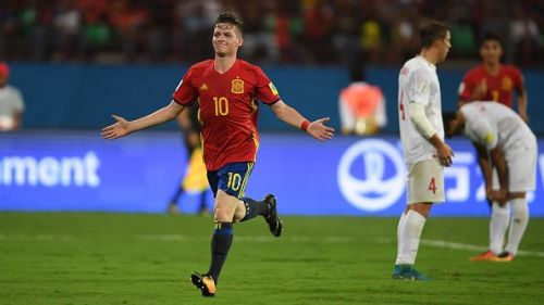 Spain's Sergio Gomez celebrates after putting one past Iran