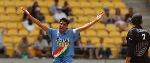 India's Asish Nehra celebrates his dismissal of Ne
