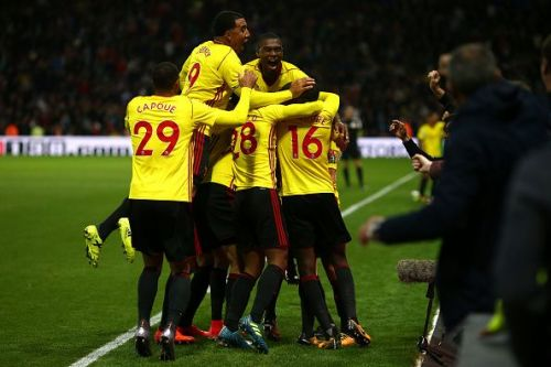 Watford players celebrate after scoring a late winner