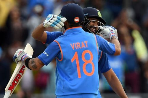 Rohit celebrates his century with Virat Kohli