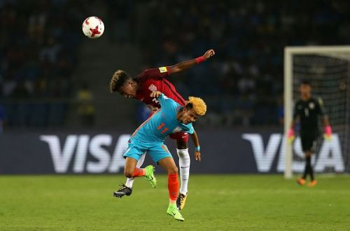 Komal Thatal fighting an aerial battle during the FIFA U17 World Cup
