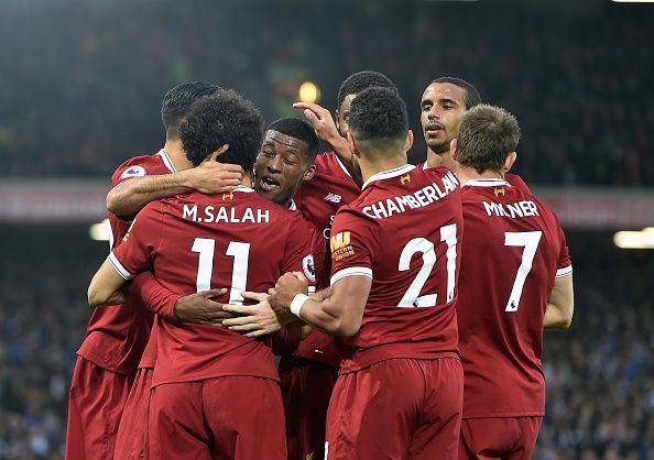 Liverpool écrase Huddersfield et garde espoir pour le titre