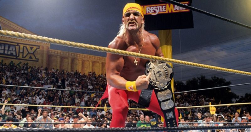 Hulk Hogan holding the title at Wrestlemania 9