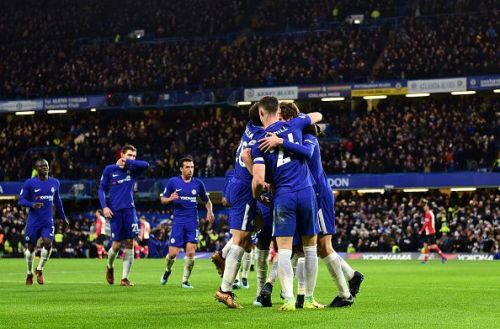 Chelsea players celebrating the only goal of the game
