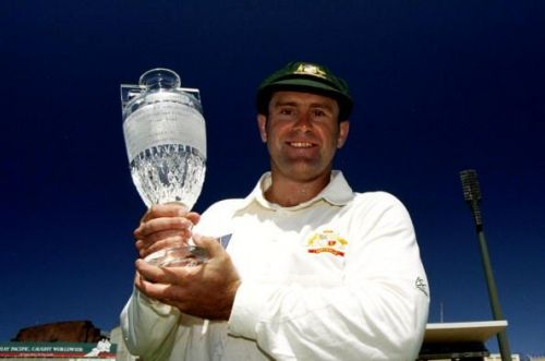Mark Taylor holds aloft the Ashes trophy