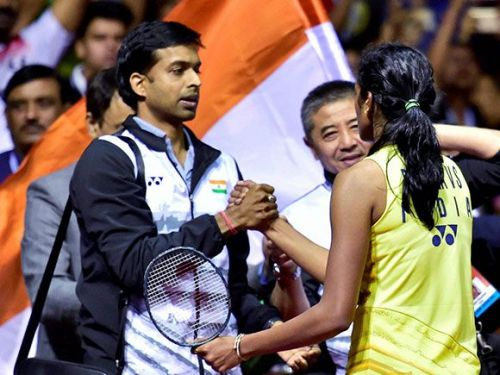 Sindhu is congratulated by coach Gopichand on her silver medal win at the 2016 Rio Olympics