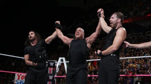 Kurt Angle in the ring with Dean Ambrose and Seth Rollins