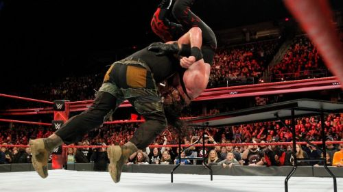 Braun Strowman laying waste to Kane after the match ended