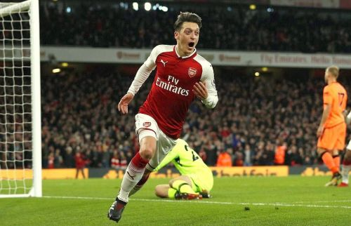 Mesut Ozil celebrating after an amazing comeback in what was one of the most entertaining games of the season.