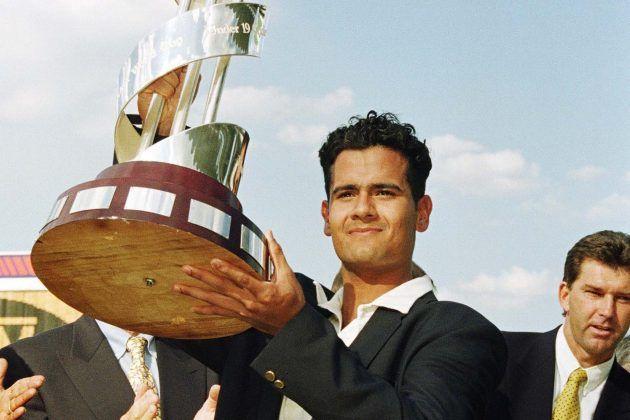 Brett Williams of Australia shows off the trophy.