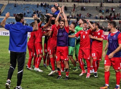 Lebanese players celebrate Asian Cup qualification with coach Miodrag Radulovic. Photo: Lebanon FA