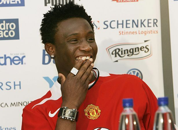 John Obi Mikel poses in a Manchester United shirt....before the move was hijacked by Chelsea