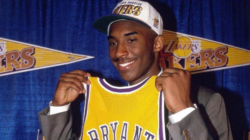 Kobe Bryant poses with his Lakers jersey