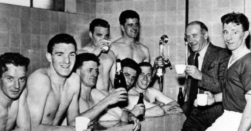 Manchester United celebrating winning the Division One League Championship 1956-1957 for the second year running. Players shown include John Berry, Bill Foulkes, Bill Whelan, Tommy Taylor, Bobby Charlton and captain Roger Byrne