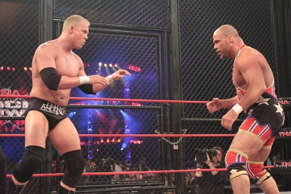 This amazing cage match took place in TNA during the Bischoff-Hogan era