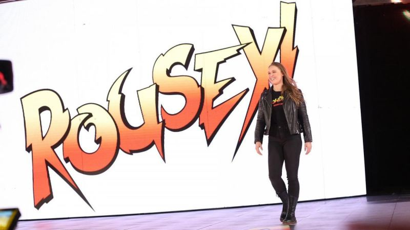 Ronda Rousey will team up with Kurt Angle to face Triple H and Stephanie McMahon