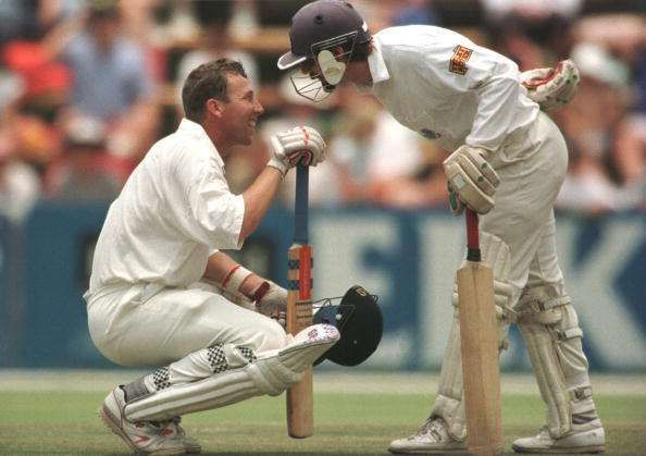 Athers and Jack Russell in conversation during their fabled partnership versus South Africa in 1995