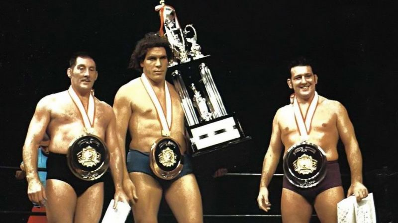 Karl Gotch, Andre the Giant, and Billy Robinson take a picture in the ring