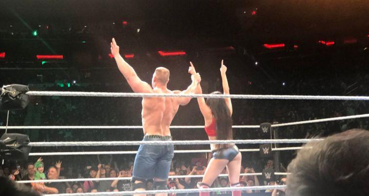 Cena and Nikki celebrate their win (Courtesy: @CavemanRobles)