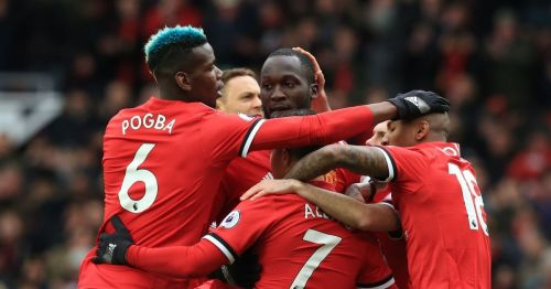 Manchester United players celebrating a goal against Swansea