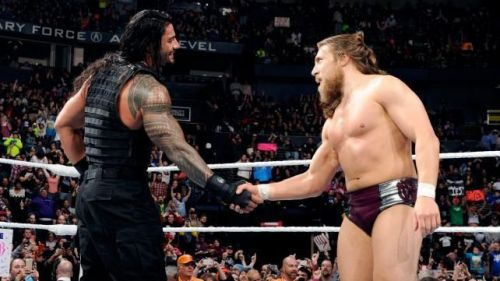 Roman Reigns shaking hands with Daniel Bryan