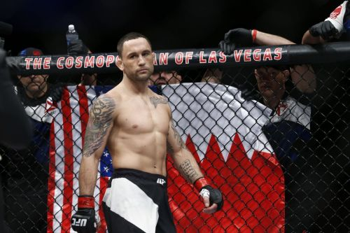 Frankie Edgar standing with the Bahraini & US Flags in the Background