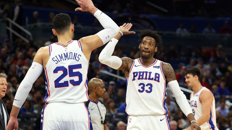 Ben Simmons and Robert Covington celebrating after scoring an AND1