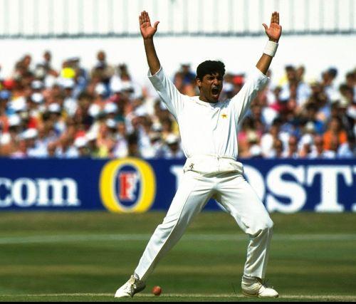 Waqar celebrating his 1st Test wicket.