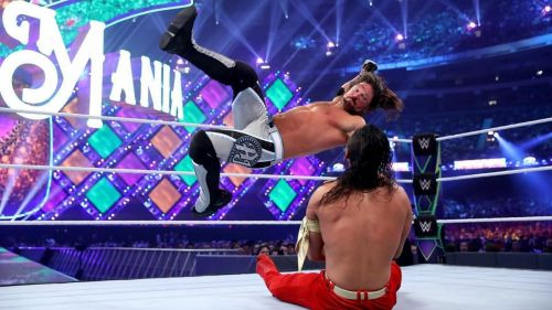 AJ Styles comes in to deliver a blow in his match against Shinsuke Nakamura