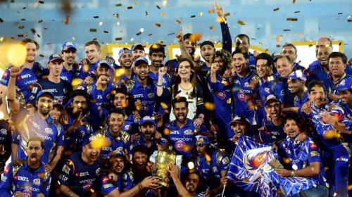 Mumbai Indians players and Owner Neeta Ambani with IPL 10 trophy after they win the IPL 10 Final match against Rising Pune Supergiants in Hyderabad on Sunday. (Photo: AP)