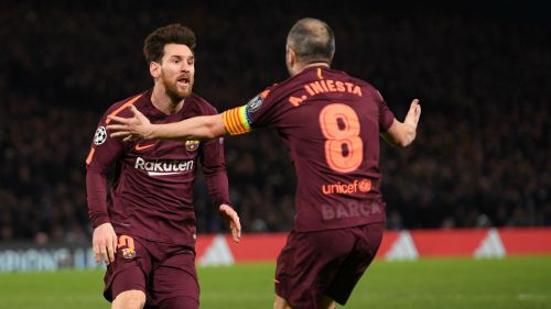 Lionel Messi with Andres Iniesta